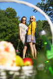 Fine shot of the two girlfriends in the park Stock Photos