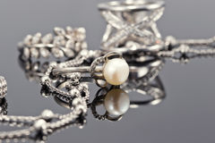 Fine silver rings and unusual silver chain Stock Photography