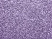 Fine sintetica di struttura del tappeto su come fondo Immagini Stock
