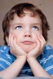 Fine small boy dreams, portrait. Royalty Free Stock Photo