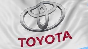 Fine su della bandiera d'ondeggiamento con il logo di Toyota, ciclo senza cuciture, fondo blu Animazione editoriale 4K ProRes, al video d archivio