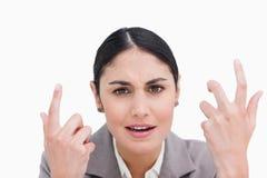 Fine in su della donna di affari di sguardo confusa Immagini Stock Libere da Diritti