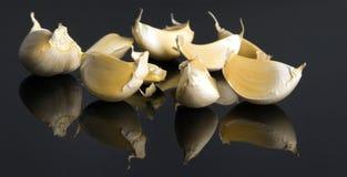 Fine in su di aglio bianco fotografia stock