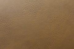 Fine sul contesto di cuoio di marrone del sofà, struttura del fondo fotografia stock libera da diritti