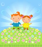 Fine sunny day. Happy girl and boy stand on a meadow full of flowers Stock Photography
