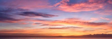 Fine sunrise on the beach. Fine orange and blue sunrise on the beach Stock Photo