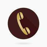 Fine Telephone Receiver Flat Icon. Fine telephone golden receiver in the brown circle. Flat design with long shadow Stock Photography