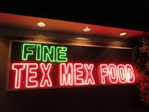 Fine Tex Mex Food. Photo of tex mex restaurant neon sign at night. Tex mex restaurants appear to be very popular in the usa royalty free stock photo