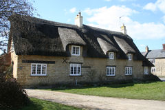 Fine thatched stone walled building. Fine thatched old English building made of locally quarried stone Stock Photo