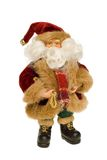 Fine toy Santa. Fine little figure of Santa Claus isolated on pure white stock image