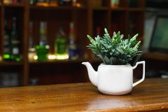 A fine white kettle for table decor stock photo