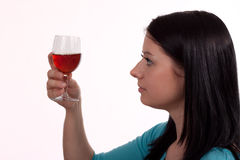 Fine Wine. Young woman holding up a glass of wine royalty free stock images