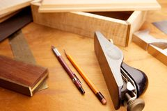 Fine woodworking. Tools and material under incandescent light Royalty Free Stock Images