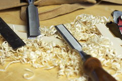 Fine woodworking chisels. Carpenters fine woodworking tools in work shop with wooden shavings Stock Photography