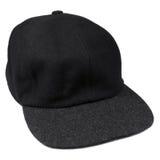 Fine wool black baseball cap grey isolated men hat. Fine wool black baseball style cap with grey brim, isolated warm men hat for autumn / winter Stock Photo
