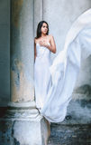 Fine young girl with a light dress. Royalty Free Stock Images