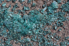 Finely broken glass lying on the ground. Stock Photo
