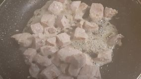 Pieces of meat in a pan. Finely chopped pieces of raw pork meat in a pan stock video footage