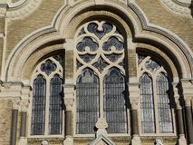 Brick synagogue building detail with stone decorated windows royalty free stock photography