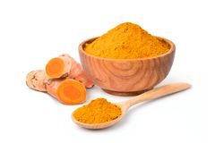 Finely dry Turmeric Curcuma longa Linn powder. In wooden bowl and spoon with rhizome root isolated on white background stock photos