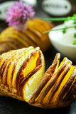 Finely sliced foil baked potato in the skin Royalty Free Stock Image