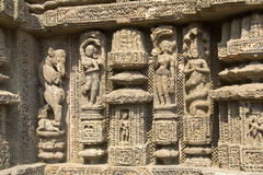 Finesse in Temple Carving. Depiction of mythological characters by deft hands on wall of Sun Temple, Konark, Orissa, India, Asia royalty free stock image