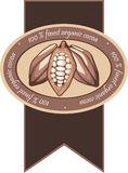 100% finest organic cocoa. A seal for food products, depicting stylized cocoa pods Stock Photography