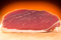 The finest prosciutto. On wooden board Stock Image