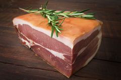 The finest prosciutto with rosemary. Stock Photos