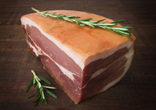 The finest prosciutto with rosemary. Stock Image