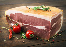 The finest prosciutto on wooden board Stock Images