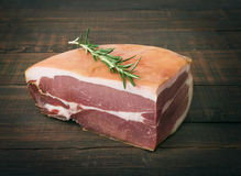 The finest prosciutto on wooden board Stock Photography