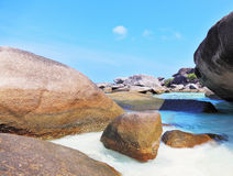 Finest white sand  between huge black cliffs Royalty Free Stock Image