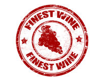 Finest wine stamp. Red grunge rubber stamp with grape and the text finest wine written inside the stamp Royalty Free Stock Photo