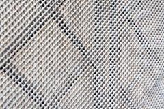 Finestra della grata del metallo nella parete Immagini Stock