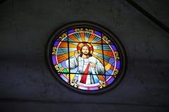 Finestra di vetro macchiata di Gesù Cristo fotografia stock