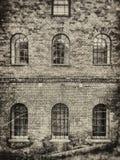 Finestre del muro di mattoni Fotografie Stock
