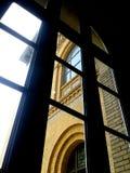 Finestre viste attraverso Windows Fotografia Stock