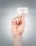 Finger. Pushing button on grey background Royalty Free Stock Photo