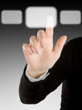 Finger. Pushing button on grey background Royalty Free Stock Photos