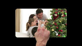 Finger activating and scrolling through christmas videos Royalty Free Stock Images