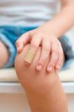 Finger with adhesive bandage. Stock Photo