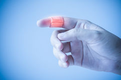 Finger with adhesive bandage Royalty Free Stock Photography