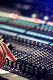 Finger adjusting audio mixer in the studio Royalty Free Stock Photos