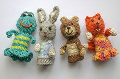 Finger animal puppets knitted from wool. Hand made. Crochet knitting cute teddy bear, frog, hare and fox. Royalty Free Stock Images