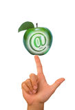 Finger with apple and at sign Stock Image