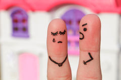 Finger art of a couple during quarrel. A man yells at a woman. Woman crying Stock Photos