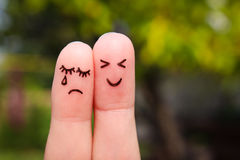 Finger art of couple. Woman cries, man is cheerful Royalty Free Stock Photo