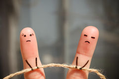 Finger art of couple. Woman and man pull rope. Stock Image
