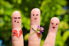 Finger art of family. Man gives bouquet of flowers to another woman. stock photography